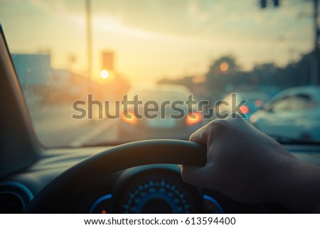image of people driving car on day time for background usage.(take photo from inside focus on driver hand)