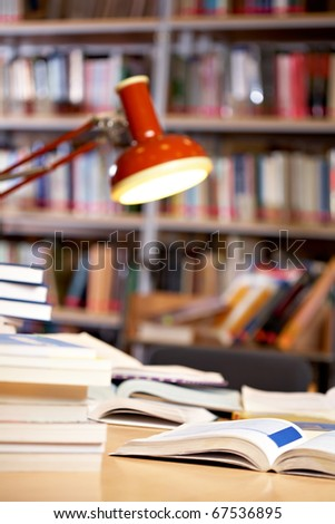 Image of place in library: table with lamp and books
