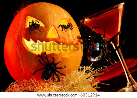 Image of poisonous drink and Halloween pumpkin with spiders on it and all around