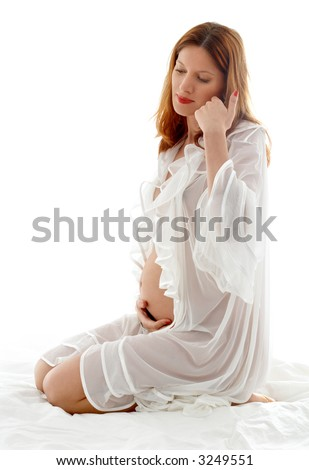 stock photo : image of pregnant redhead in transparent sleepwear