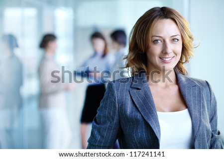 Image of pretty businesswoman looking at camera #117241141