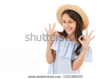Image of pretty cute girl standing isolated over white wall background showing okay gesture.