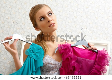 Image of pretty female thinking what dress to wear on New Year night