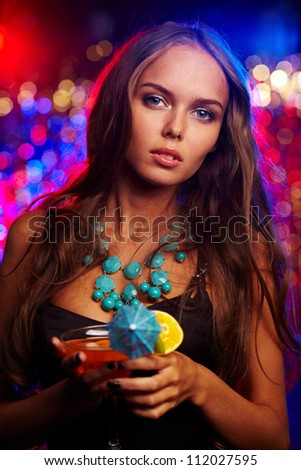 Image of pretty girl with cocktail in the night club
