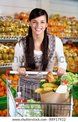 Image of pretty woman with cart looking at camera