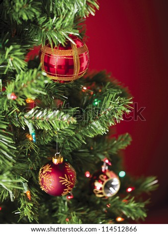 Image of red christmas bauble  with christmas lights