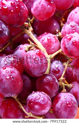 Image of red grape background with water drops