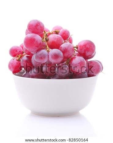 Image of red grape in bowl isolated on white