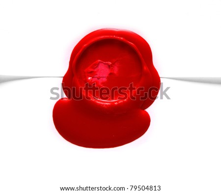 Image of red wax stamp over white envelope