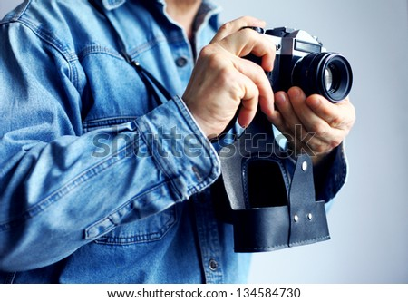 Image of reporter with film camera - stock photo