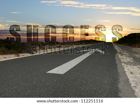 Image of road with white arrow directing forward