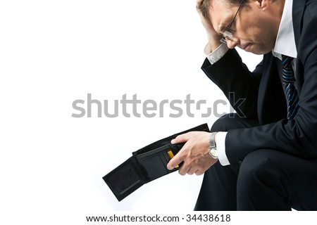 Image of sad businessman holding empty wallet and grieving