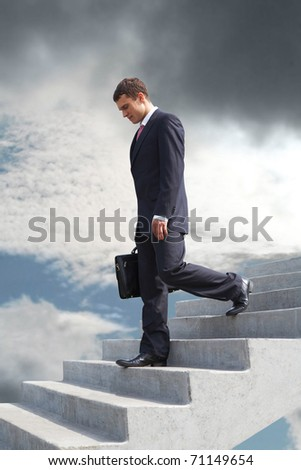 Image of sad businessman walking downstairs