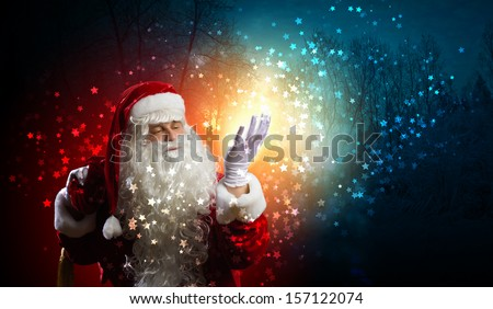 Image of Santa Claus in red costume against dark background
