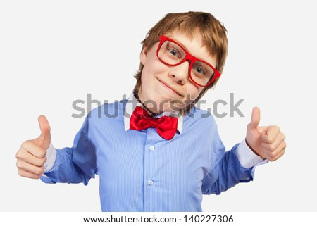 Image of schoolboy smiling showing thumbs up
