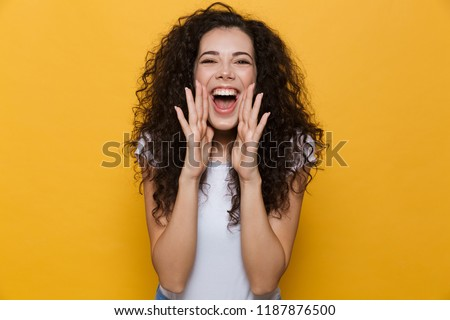 Image of screaming excited young cute woman posing isolated over yellow background. #1187876500