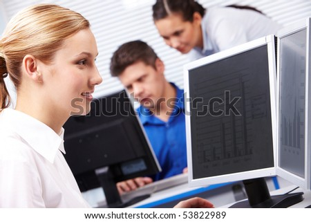 Image of secretary typing on the background of working people