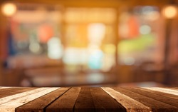 image of selective focus on surface of wood table and blur people at japanese restaurant for background usage .