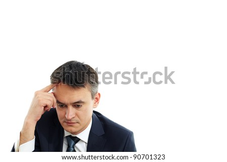 Image of serious businessman touching his forehead while thinking