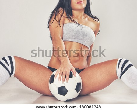 Image of sexy girl posing with ball