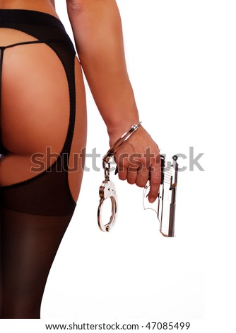 image of sexy girl wearing handcuffs and holding gun