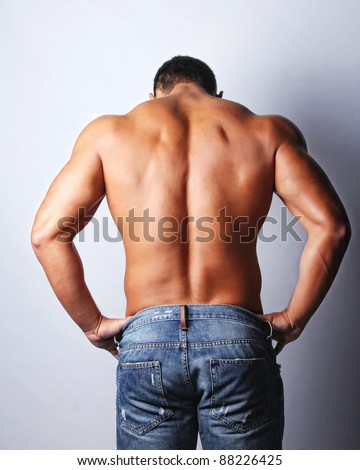 Image of sexy muscular mans back, isolated on grey