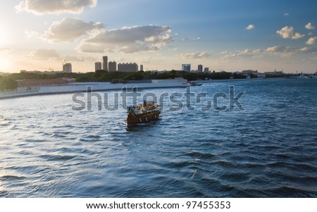 Image of ship in the sea. In the background the skyscrapers of Dubai.