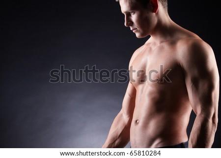 Image of shirtless man over dark background