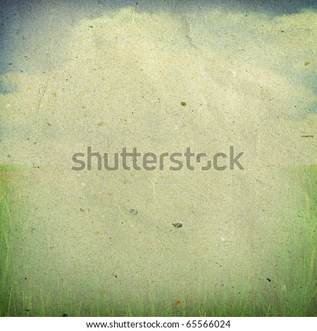 Image of sky and green field on old paper