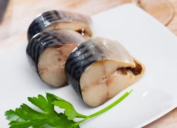 Image of slices of lightly salted mackerel fish served with greens