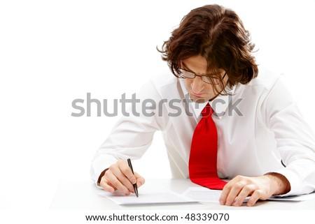 Image of smart business man writing something on document