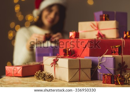 Image of smiling girl opening Christmas presents #336950330