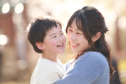 Image of smiling parents and children