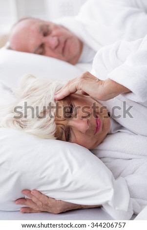Image of snoring husband and his wife with headache  #344206757