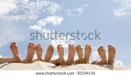 Image of soles of people lying in line