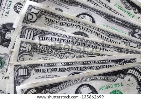 image of some dollar banknotes of different face-value - stock photo