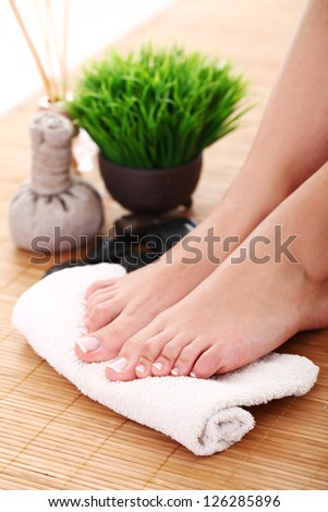 Image of SPA pedicure on bamboo surface