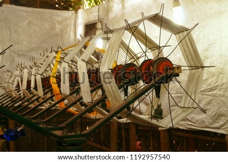 Image of spool of threads inside a silk weaving store in the silk weaving town of Sualkuchi, Guwahati in Assam, India