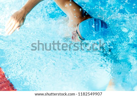 Image of sportsman swimming in style of crawl in swimming pool