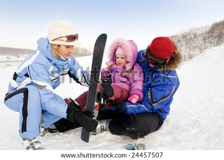 Image of sporty family spending time on winter resort during vacations