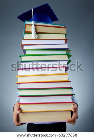 Image of stack of books held by child