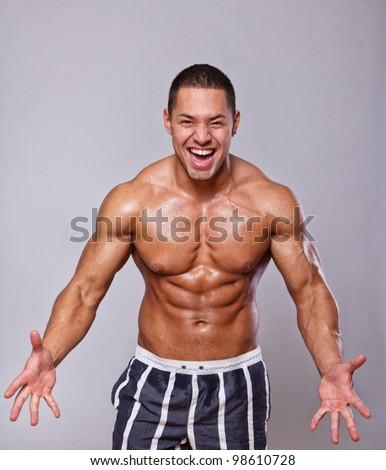 Image of standing sexy man in shorts
