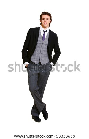 Image of successful businessman in elegant suit posing before camera