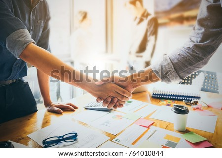 Image of Successful businessmen partnership handshaking after acquisition. Meeting for sign contracts and Group support concept. #764010844