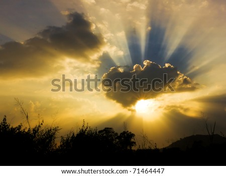 Image of sun shine through rain cloud