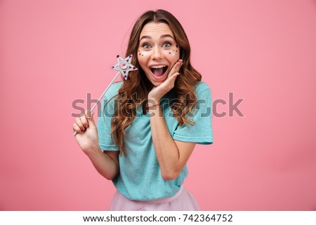 Image of surprised emotional young woman isolated over pink background holding magically stick star and looking camera. #742364752