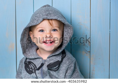 Stock Photo Image of  sweet baby boy, closeup portrait of child, cute toddler with blue eyes
