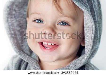 Image of  sweet baby boy, closeup portrait of child isolated on white background, cute toddler with blue eyes