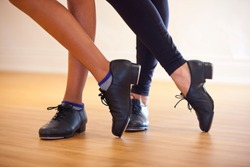Image of tap shoes from a tap dance class in a dance studio.