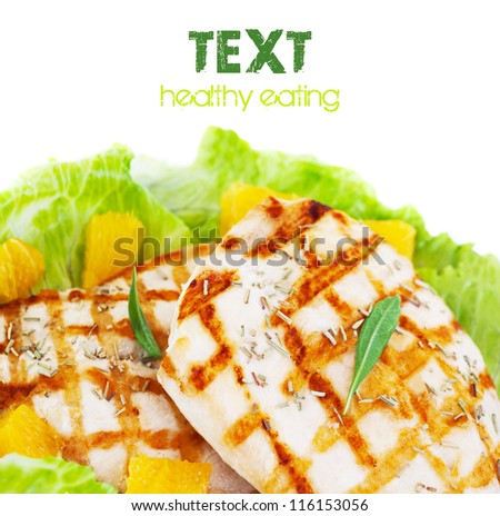 Image of tasty grilled chicken fillet with fresh vegetable isolated on white background, roasted turkey with green lettuce salad and orange fruits, text space, poultry barbecue, healthy food concept
